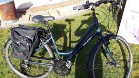 Raleigh Pioneer 2/ladies hybrid bike: Matt blue alloy frame, 21 gears, kick stand+ paniers/bell