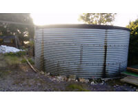 Galvanised steel 12,500 gallon (56,000 litres) water storage tank with pump