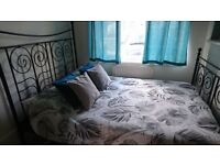Metal Black IKEA King size bed frame with mattress