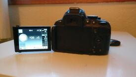 Nikon D5100 with 18-55mm lens for sale.