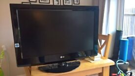 """32"""" LG TV with wall mount and remote control"""