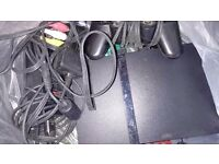PLAYSTATION 2 WITH CONTROLLER, WIRES AND 8 GAMES