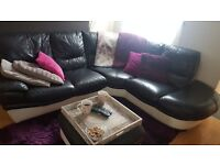 Large DFS corner sofa with storage ottoman. Black and cream leather