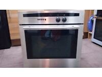 Cooker with hob and hood