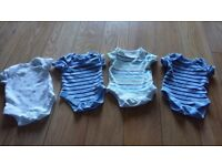 Tiny baby boy sleep suits and vests