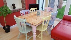 Solid pine farmhouse table and 6 chairs in different coloured pastel shades