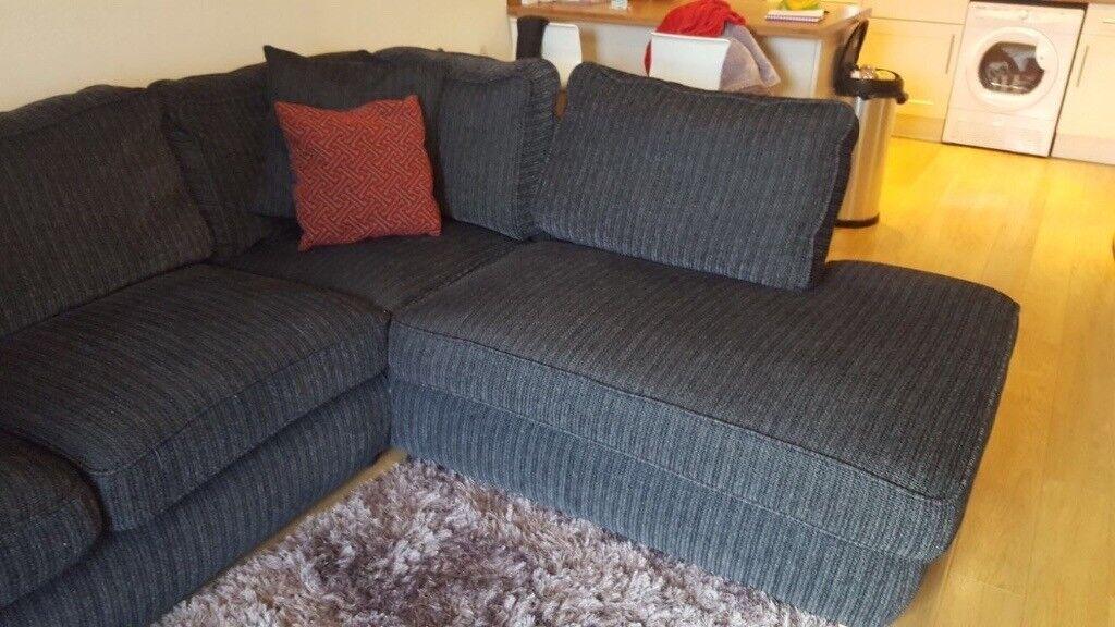 12 month old dark grey fabric corner sofa.