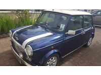 Blue with white stripes. Extra low mileage!!
