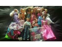 Barbie and Ken dolls plus clothes and accessories