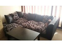 Black and gray corner sofa in wery good condition