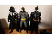 2 batman figures and one darth vader