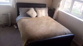 Dark Brown Leather Double Bed along with very good quality /Mattress