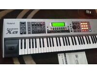 Roland Fantom Xa keyboard with manual and stand.