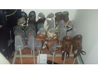 SHOE RACK CAN BE HUNG UP ON A WALL . HOLDS 12 PAIRS