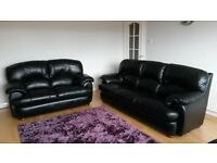 Two and Three seater sofas in black leather very good condition.