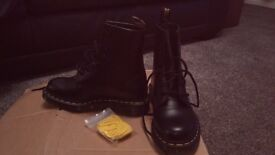 Black Doc martens boots size 3 never been worn. Extra set of yellow laces