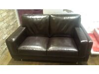 Super comfy, contemporary faux leather sofa in black/ brown