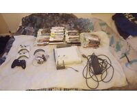Xbox 360 with 3 controllers + 1 hard drive + 2 memory cards + wireless adapter + headset +45 games