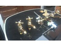 set of gold bathroom taps