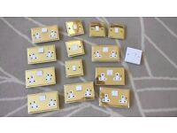 Job lot of Brass effect double switched sockets and light switches
