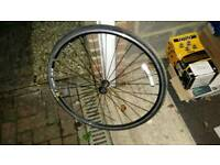 Road bike front wheel and tyre