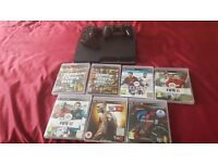 PS3 Slim, 2 controllers & 7 Games
