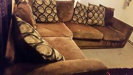 brown corner sofa and cusions
