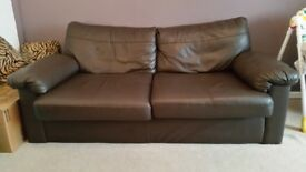 Three-seater brown leather couch