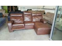 Tan leather chaise longue with recliner. Will deliver