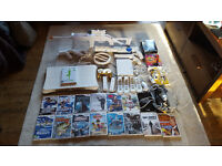 Wii Games Console Bundle. Wii Fit, Motion Sensor controllers with loads of Games and Accessories