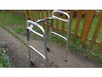 Folding walking frame with wheels. Nearly new.