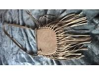 suede handbag with fringe
