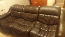 Dark brown leather sofa.