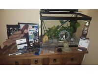 Fish tank wih loads of accessories and water conditioners/test kit