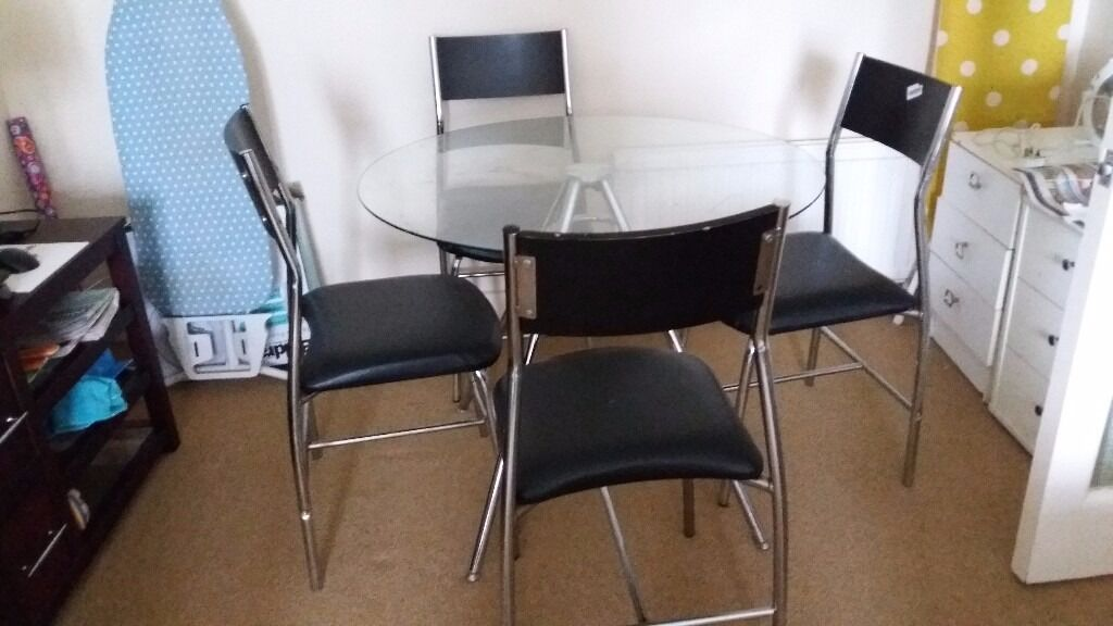 Glass dining table available in good condition