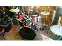 Preformance Percussion Drum kit metalic red 5 piece, cow bell, sticks and silence pads included