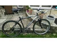 Schwinn moab mountain bike. Rideable but selling as spares or repair
