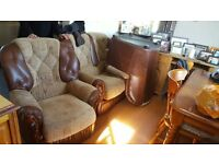 brown leather sette and two arm chairs