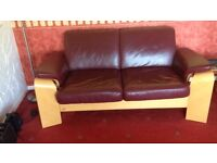 Two settees leather and stool one is a recliner