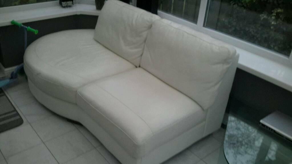 Corner settee in white leather