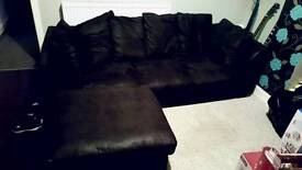 Black leather look corner sofa