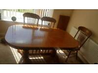 Beautiful wooden table with 6 chairs and extension