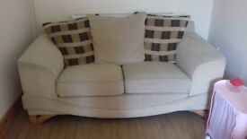 Lovely cream 2 seater sofa. Very comfy