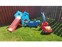 Childrens slide, seesaw and push along car with safety belt