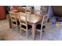 Solid oak 8 seater extending dining table and 6 chairs