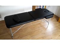 Light weight portable massage/beauty therapy couch in black.