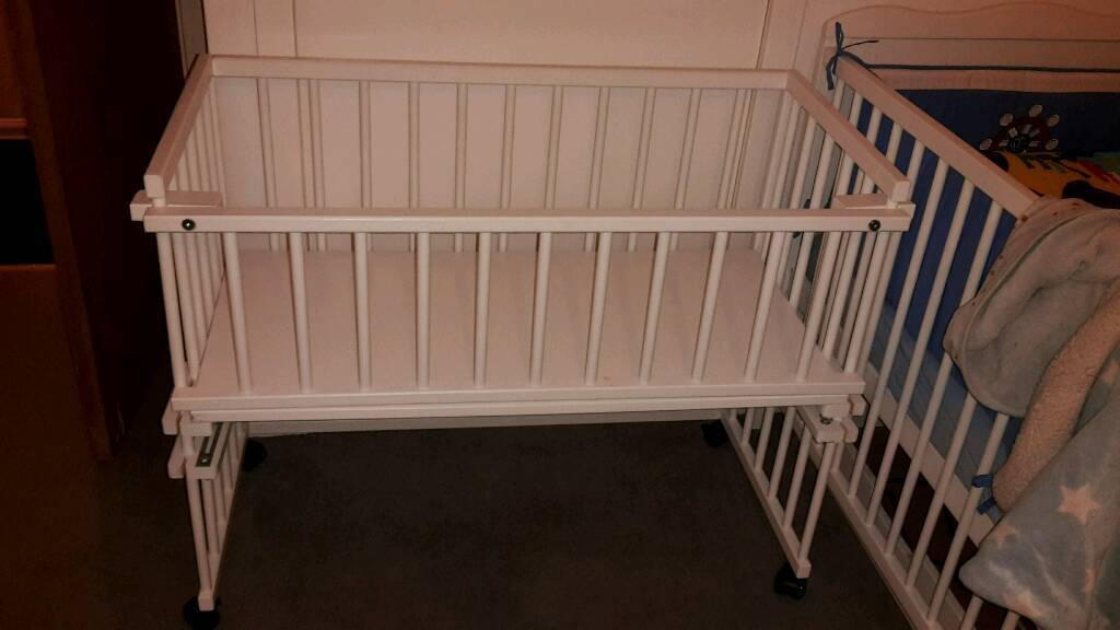 Beside the bed crib NEED GONE!