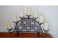 A metal candelabra holding 8 candles