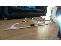 wooden train track with trains