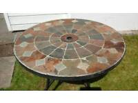Garden Table Italian design solid steel with stone tile top.
